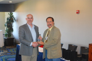 Receiving the award for San Benito County: Adam Goldstane, RA and Rob Unholz CCAEA President.