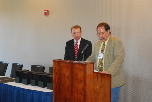 Presenting the awards are Andrew Bohnert, Jury Foreperson and Rob Unholz CCAEA President.